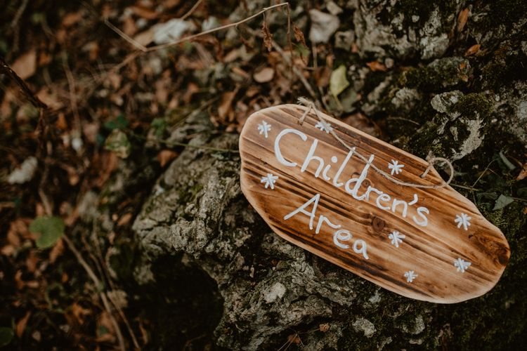 Wooden Sign | Wedding Decor | Macramé & Dreamcatcher Woodland Wedding at Upthorpe Wood | Boho Bride in Flower Crown & Kula Tsurdui  Wedding Dress | Groom in Navy Blue Suit  | Camilla Andrea Photography