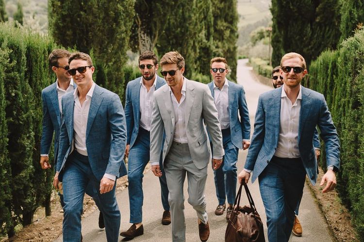 Groom in Pale Blue Suit from Canali and Groomsmen in Blue Suits from Suit Supply