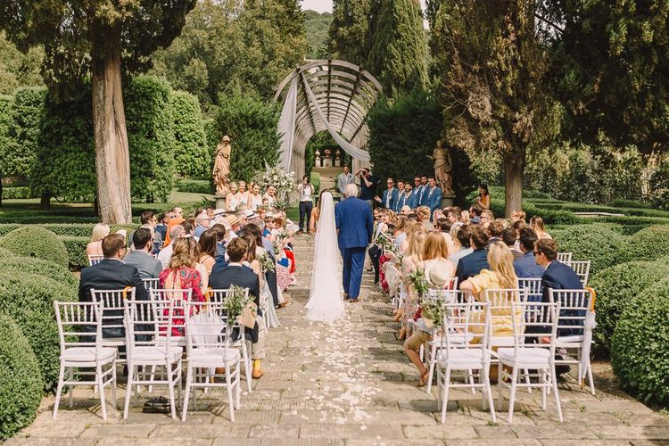 Outdoor Italian Wedding Ceremony Bride Walking Down the  Aisle with Veil