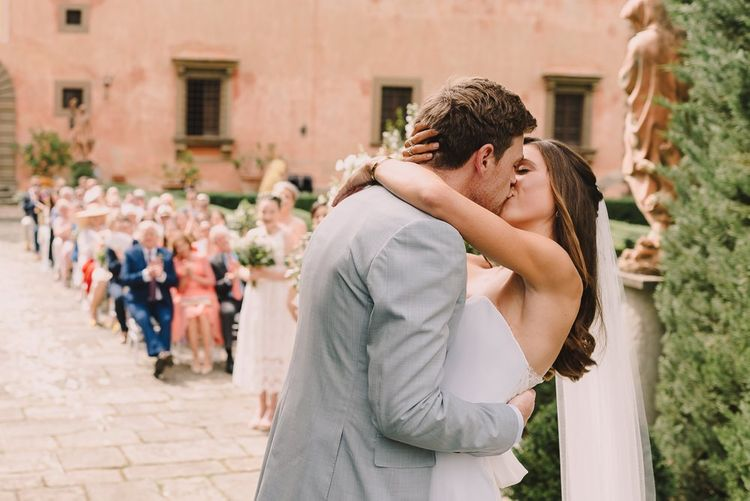 Bride and Groom Kiss At Tuscan Wedding Ceremony