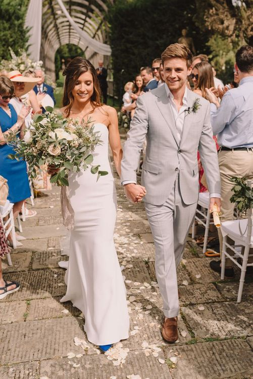 Ceremony Exit with Bride Holding Romantic Pastel Bouquet of Flowers from Flowers Living