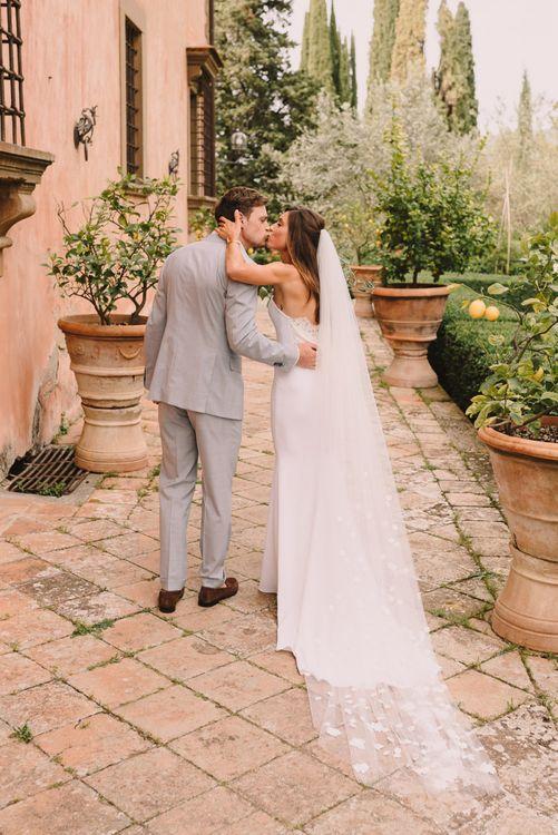 Bridal Veil Trailing Behind Beautiful Lace Back Dress