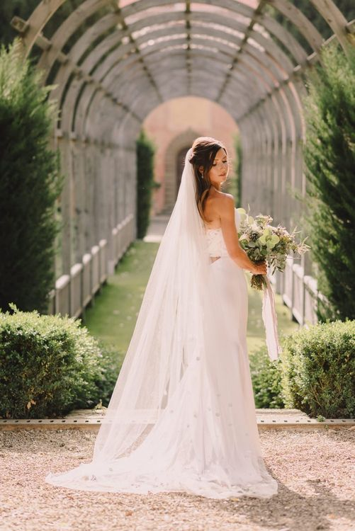 Bride in Dress With Lace Back and Tie Detail from Lihi Hod holding Flower Bouquet from Flowers Living