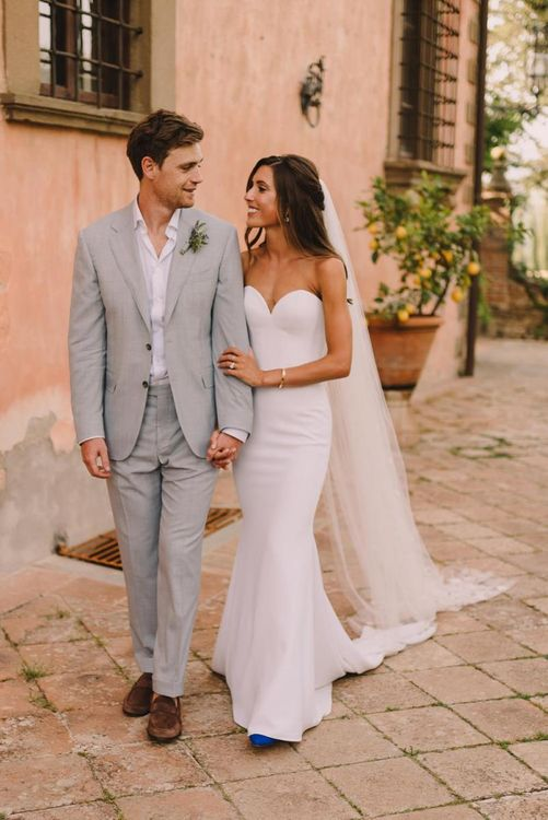 Bridal Dress with Sweetheart Neckline with Long Veil  and Groom In Blue Suit