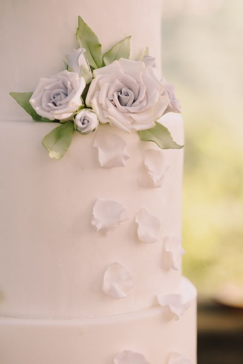 White Wedding Cake with Flowers and Petals