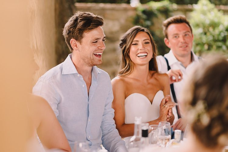Bride with Sweetheart Neckline Dress and Groom at reception