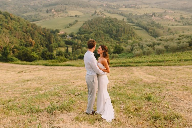 Bride & Groom Embracing After Ceremony in Tuscan Countryside