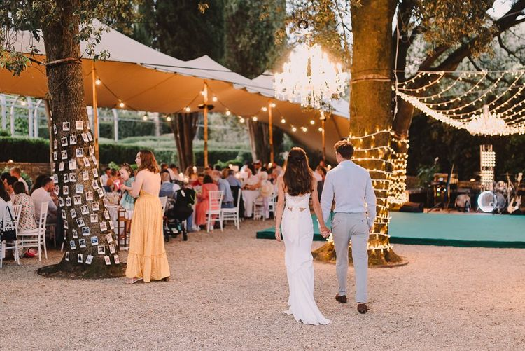 Bride & Groom at Reception with Fairylights and Photos