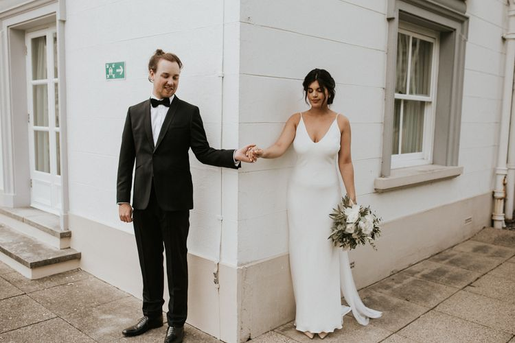 First Look with Bride in Grace Loves Lace Slip Wedding Dress and Groom in Tuxedo