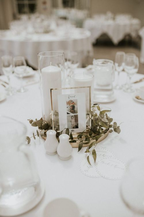 Table Centrepiece with Gold Platter, White Candle and Foliage