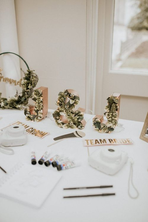 Gold Spray Painted Initials Filled with Foliage
