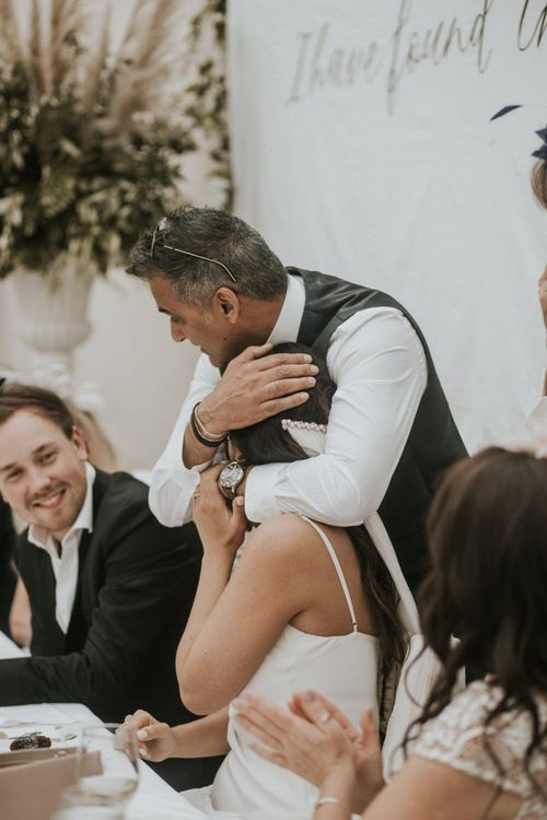 Father of The Bride Hugging His Daughter During The Wedding Reception Speeches