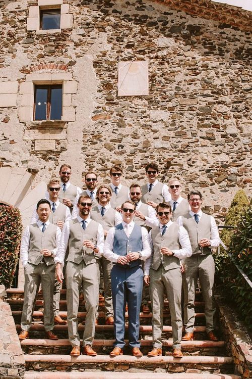 Groom with groomsmen in matching cream waistcoats