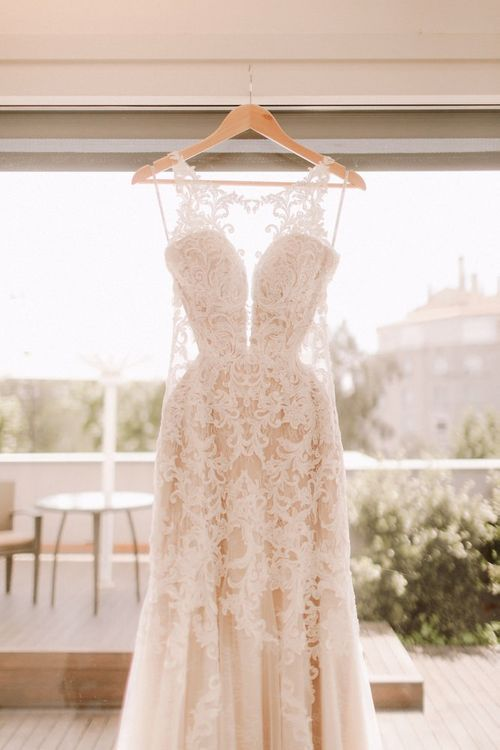 Essense of Australia wedding dress hanging for bride to put on