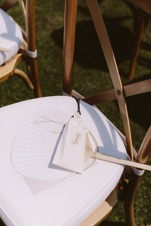 Wedding ceremony seats with fan for guests