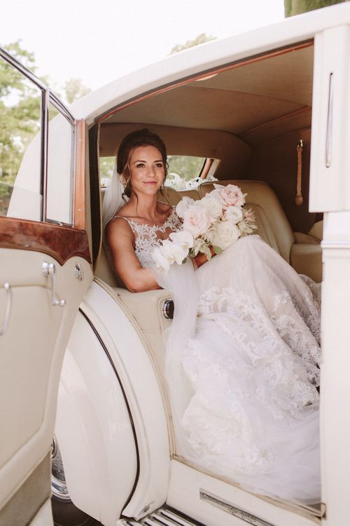 Bride in Essense of Australia wedding dress in wedding car