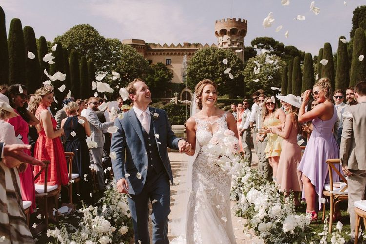 Confetti exit for bride in Essense of Australia wedding dress and groom at Spanish venue