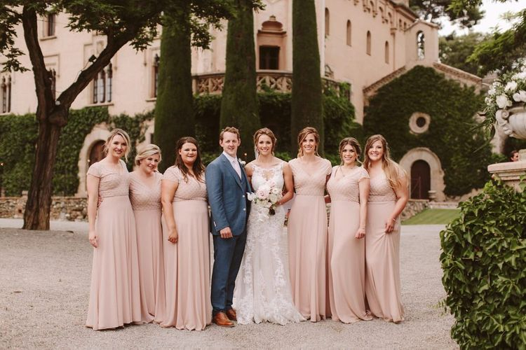 Pink bridesmaid dresses with bride in Essense of Australia wedding dress