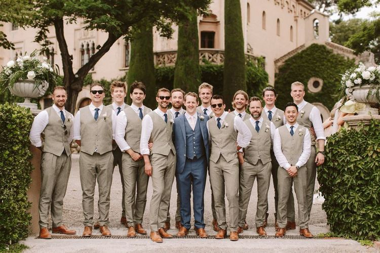 Groom with his groomsmen in cream waistcoats
