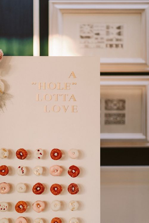 Wedding sign on doughnut wall for celebration with Essense of Australia wedding dress