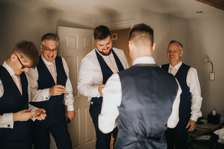 Groom and groomsmen getting ready for Washingborough Hall wedding