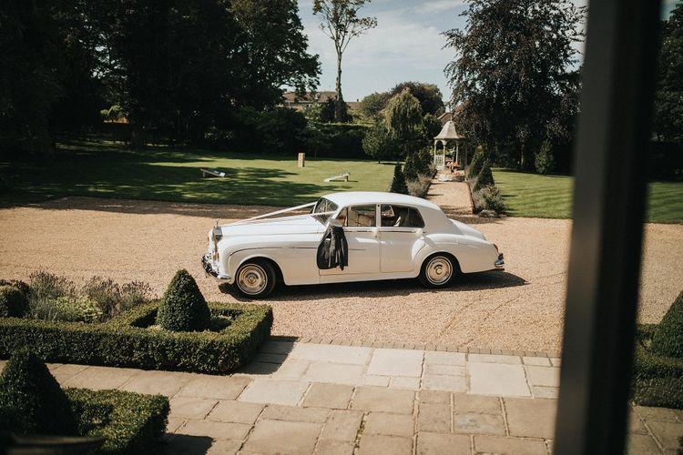 White vintage wedding car for Washingborough Hall wedding