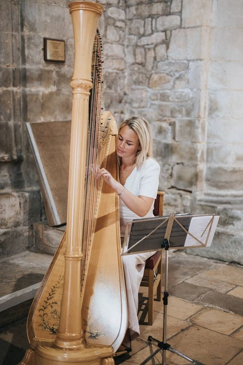 Harpist at church wedding ceremony