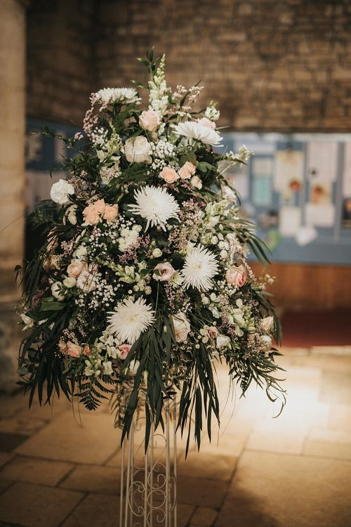 Blush wedding flowers at church wedding ceremony