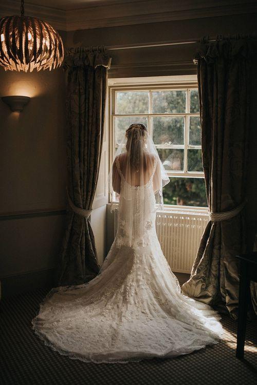 Low back lace Pronovias wedding dress