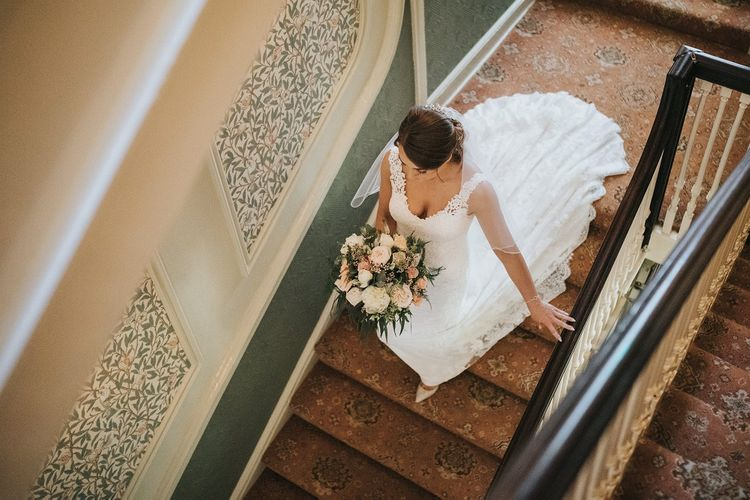 Bride with bouquet makes her way to wedding ceremony