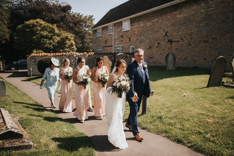 Bridal party on their way to church wedding ceremony