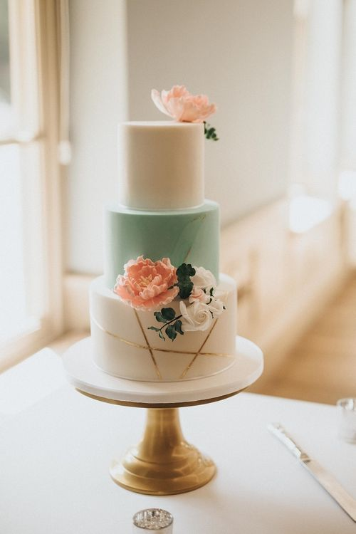 Mint and gold wedding cake with flower decor