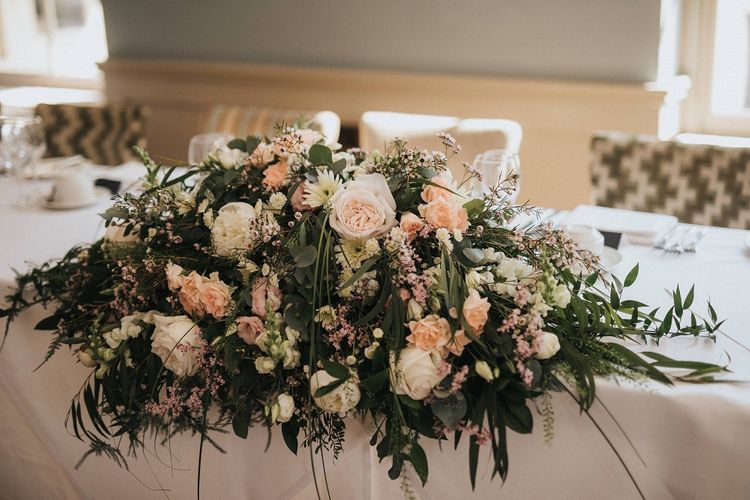 Blush and white wedding table flowers