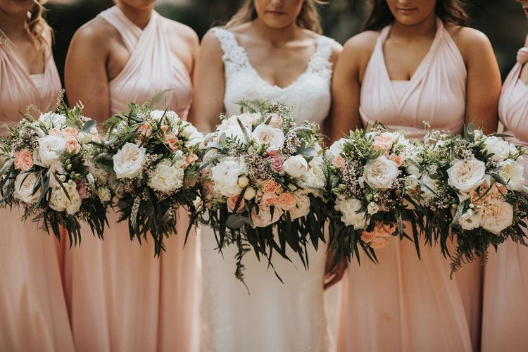 Bridesmaid bouquets with pink flowers
