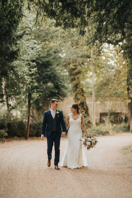 1069Bride and groom walk through Washingborough Hall gardens
