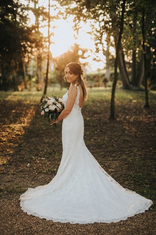 Pronovias wedding dress with low back and lace detail