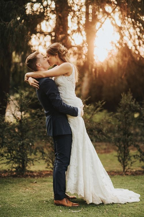 Bride and groom walk through Washingborough Hall gardens