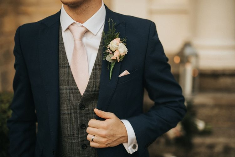 Groom with pink tie and flower buttonhole