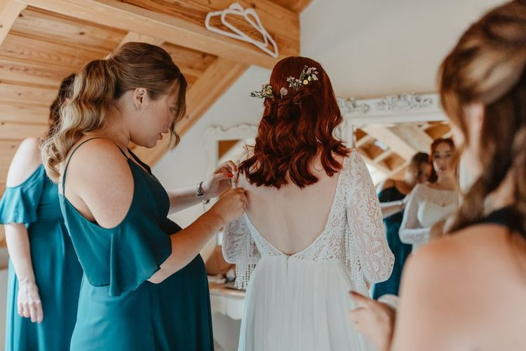 Bridal Preparations with Bridesmaids Helping Bride Get Ready