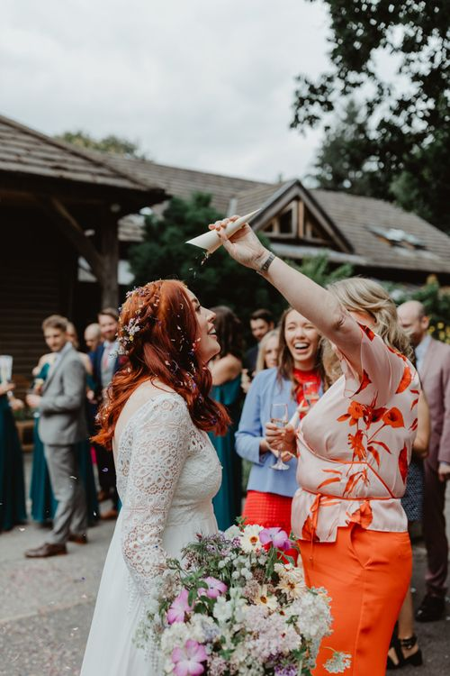 Guest Pours Leftover Confetti On Bride