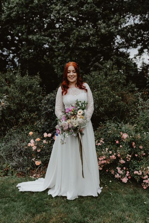Bride With WildFlower Bouquet and Lucy Can't Dance Lace Dress