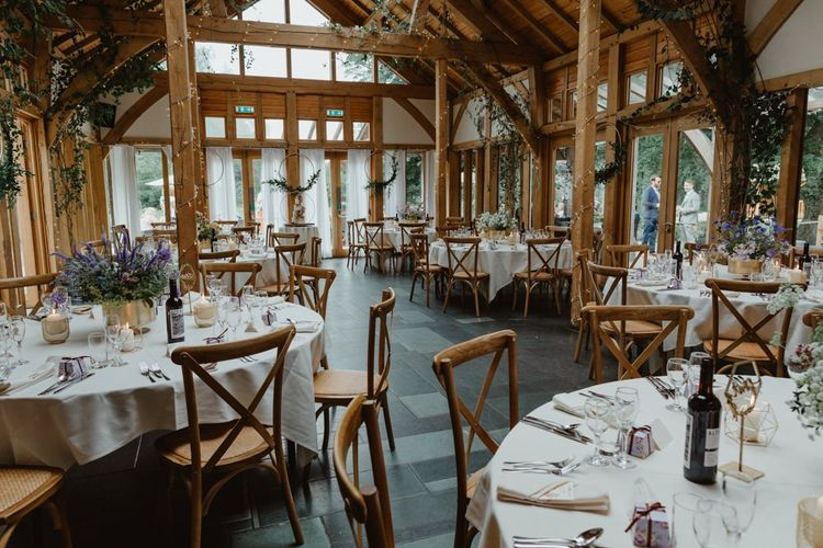 Rustic Wedding Venue Decorated With Wildflowers
