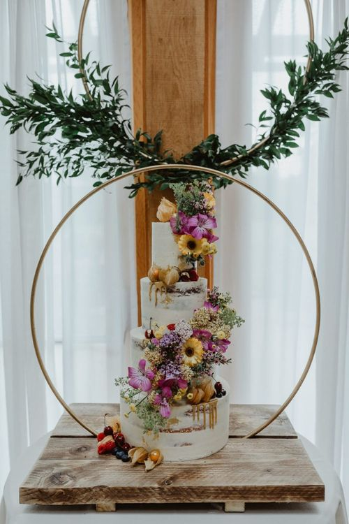 Wildflower Tiered Wedding Cake With Hoop Decor