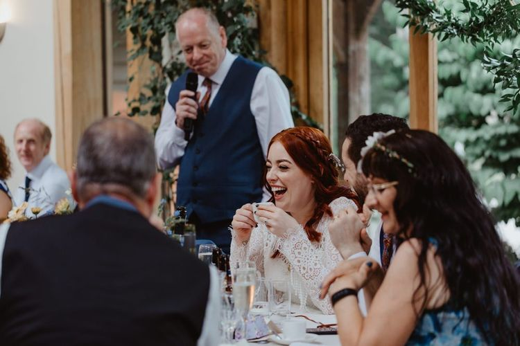 Bride Laughs During Speeches