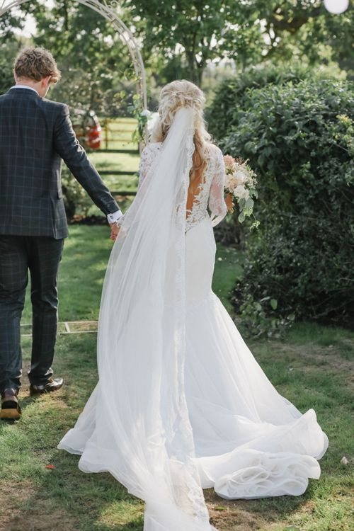 Bride in Lace Fishtail Wedding Dress and Groom in Blue Check Most Suitable Suit  Holding Hands in the Country side