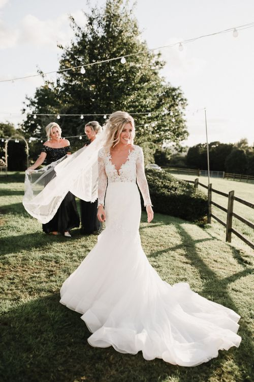 Beautiful Bride in Lace Fishtail Nicole Spose Wedding Dress with Long Sleeves