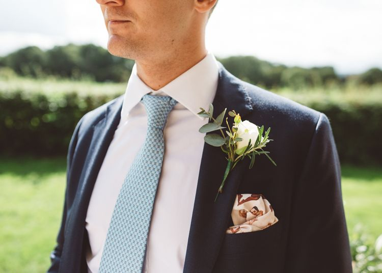 Blue Tie With White Rose Buttonhole // Valeria By Pronovias Bridal For Elegant At Home Wedding With Clear Marquee And White Florals And Images From Holly Carlin Photography