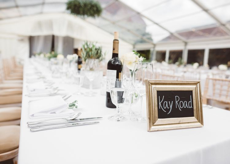 White Linen Place Setting // Valeria By Pronovias Bridal For Elegant At Home Wedding With Clear Marquee And White Florals And Images From Holly Carlin Photography