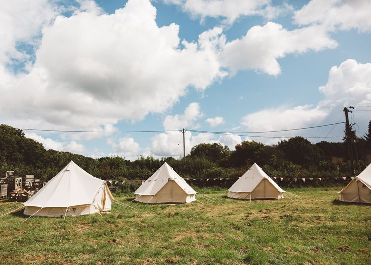 Bell Tent Camping For Wedding Guests // Valeria By Pronovias Bridal For Elegant At Home Wedding With Clear Marquee And White Florals And Images From Holly Carlin Photography