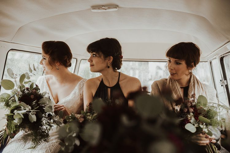 Bride and bridesmaids on way to ceremony with foliage bouquets